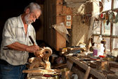Wood worker in old shed — Stock Photo