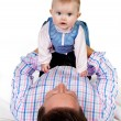 Stock Photo: Baby on father's belly