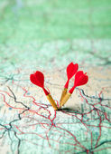 Green map with red darts — Stock Photo