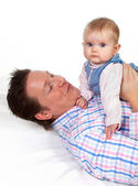 Baby playing with her daddy — Stock Photo