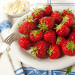 Cream and strawberries — Stock Photo