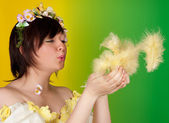 Fluffy easter feathers in springtime — Stock Photo
