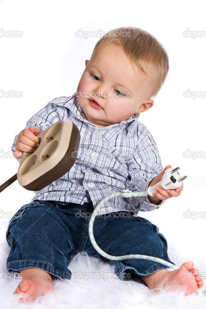 Curious boy playing with plugs and outlets — Stock Photo #8704592