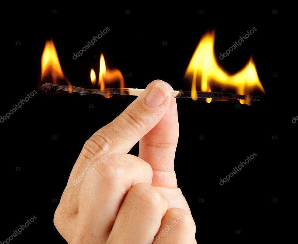 Hand holding a match burning at both ends — Stock fotografie #8738032