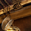 Books and antique pocket watch — Stockfoto