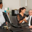 Secretary on manager lap — Stock Photo #8795616