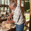 Old shed and skilled carpenter — Stok Fotoğraf #8796626