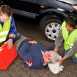 Paramedics with injured man — Stock Photo