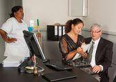 Secretary on manager lap — Stock Photo