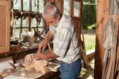 Old shed and skilled carpenter — Stock Photo