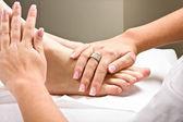 Massaging feet — Stock Photo