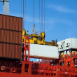 Container on red ship - Stock Photo