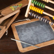 Slate and abacus — Stock Photo