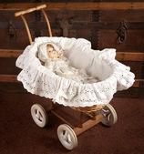 Antique doll in cradle — Stock Photo