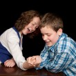 Постер, плакат: Arm wrestling teenagers