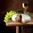 Sacred wine and bread — Stock Photo
