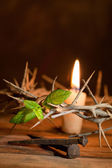 Thorns and candle at Easter — Stock Photo