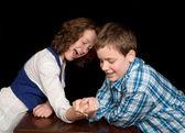 Arm-wrestling teenagers — Stock Photo