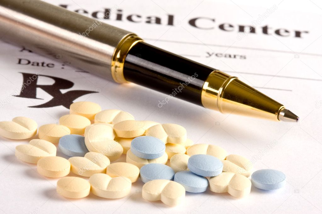 Several little pills and a pen lying on a prescription document  Stock Photo #8857045