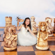 Mini girl on chessboard — Stock Photo