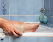 Pumice stone removing callus — Stock Photo