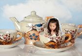 Miniature girl on tea party — Stock Photo