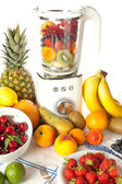 Blender and fruit — Stock Photo