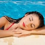 Swimming pool girl — Stock Photo