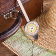 Distance meter and suitcase — Stock Photo