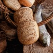 Bread and fresh fish — Stock Photo