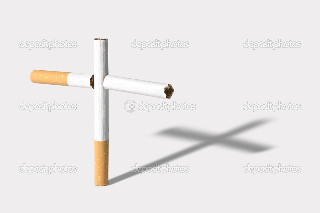 Graveyard cross made of cigarettes, casting a shadow — Stock Photo #9139604