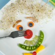 Food face on plate — Stock Photo