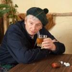 Funny Scotsman drinking whisky — Stock Photo #9180960