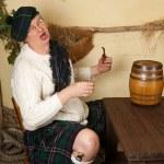 Funny Scotsman drinking whisky — Stock Photo #9180966