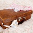 Stock Photo: Vintage garter en suitcase