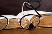 Antique glasses and book — Stock Photo