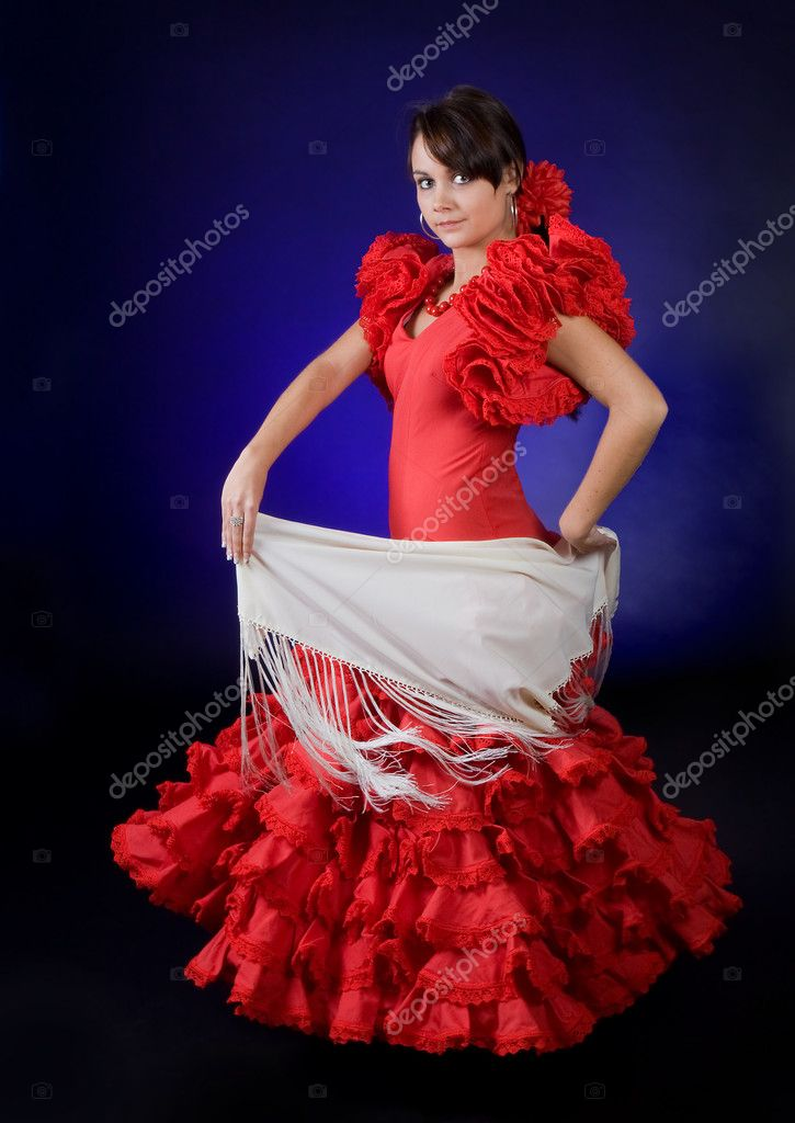 Young Spanish flamenco performer in a gorgeous red dress  Stock Photo #9515156