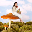 Fairy child on a toadstool — Stock Photo