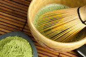 Bamboo wire whisk and japanese tea — Stock Photo