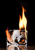 Hard drive on fire — Stock Photo