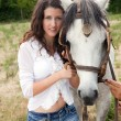 Portrait of a woman with a horse — Stock Photo #9656672