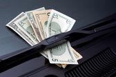 Money under windshield wiper — Stock Photo