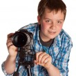 Teenager with digital camera — Stock Photo