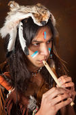 Indian with flute — Stock Photo