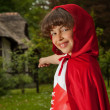 Red riding hood pointing — Stock Photo