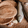 Five loaves of bread and two fish — Stock Photo