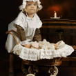 Antique girl and doll — Stock Photo