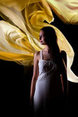 Woman with yellow waves — Stock Photo
