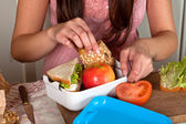 Preparing a lunchbox — Stock Photo