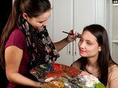 Make-up artist at work — Stock Photo